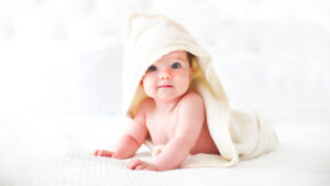 Cute Baby Wearing Bathrobe with Hood White Background