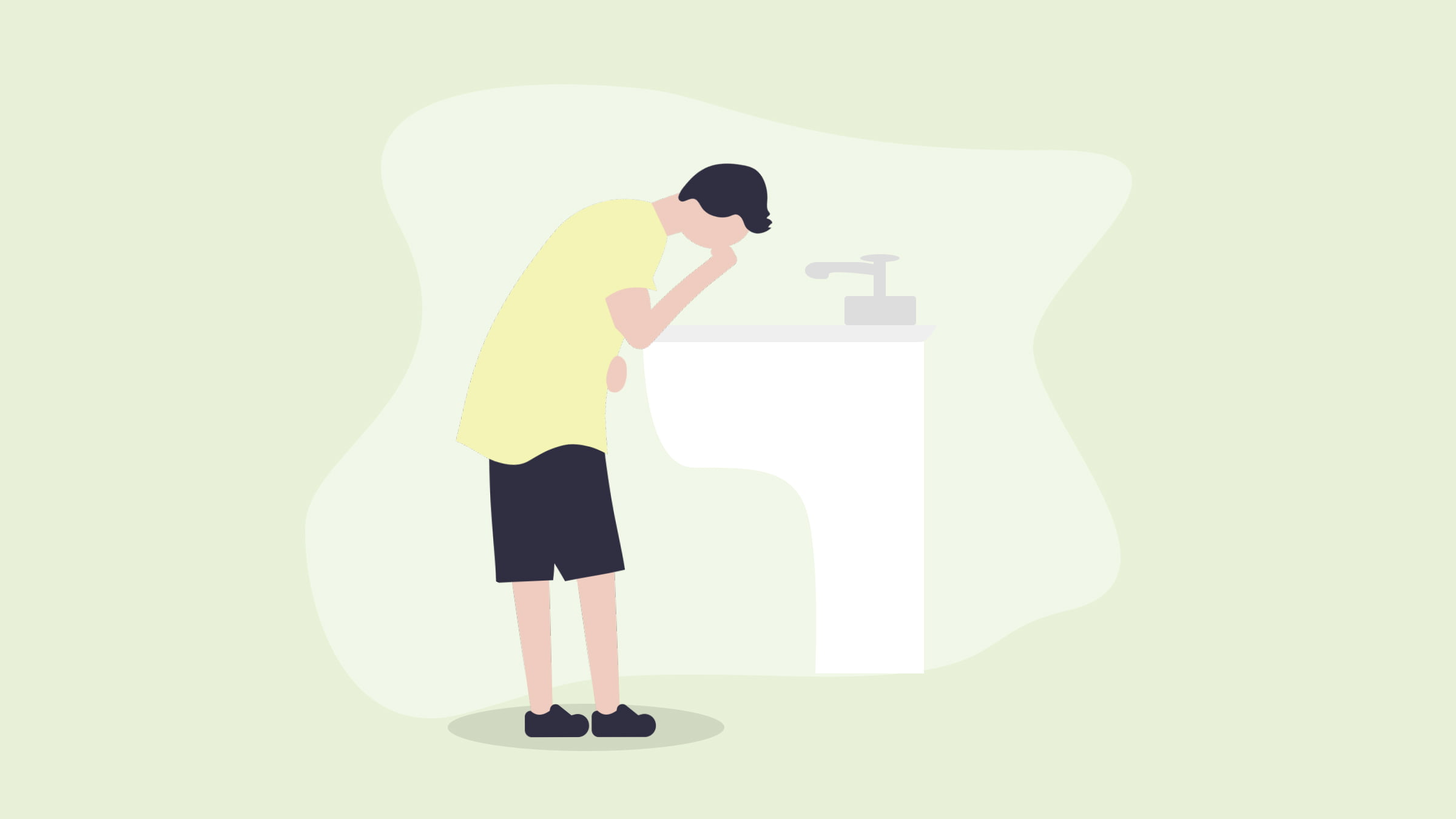 A man washing his face after suffering from nausea