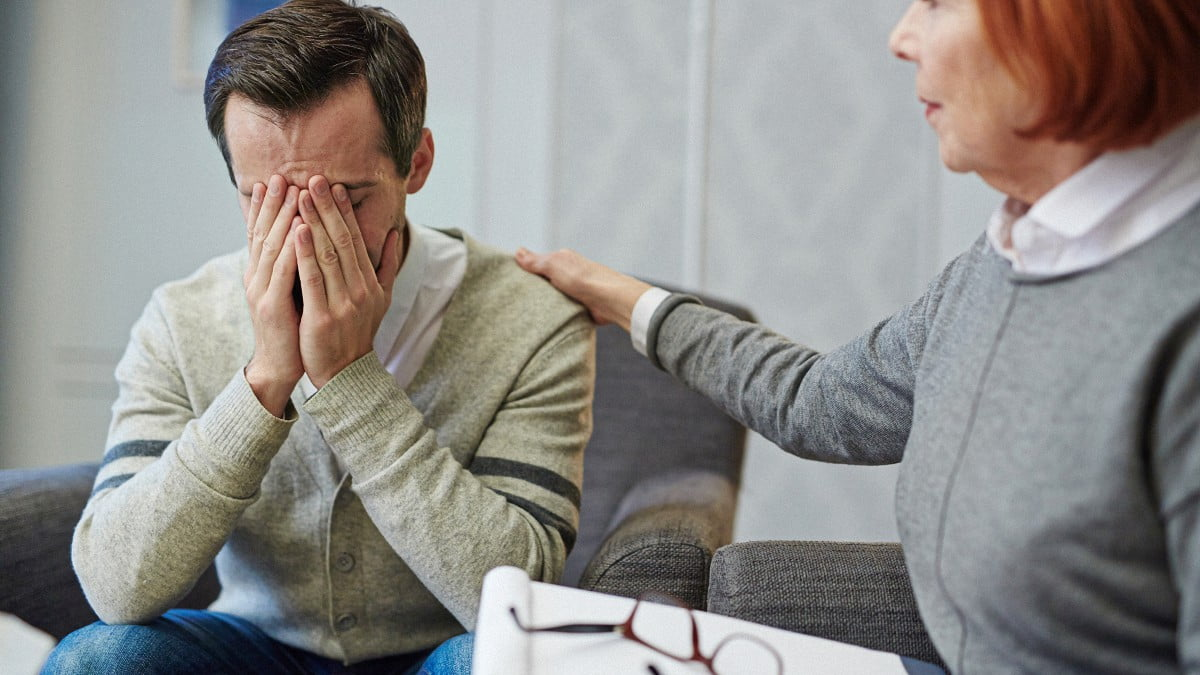 Man upset during a therapy session with his therapist