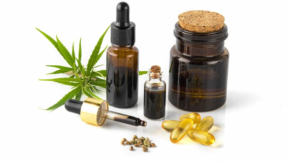 CBD Oil in Bottle and Capsules with Hemp Flower