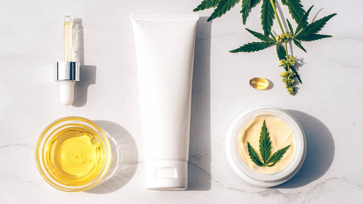 CBD Products with Hemp Flower in White Background