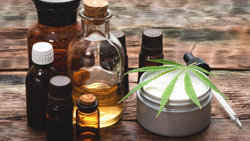 CBD Products in a Wooden Surface