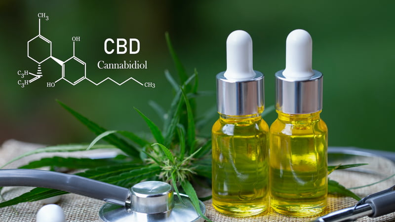 Two CBD Oil Bottles with Hemp Leaves and CBD Molecular Structure and Stethoscope