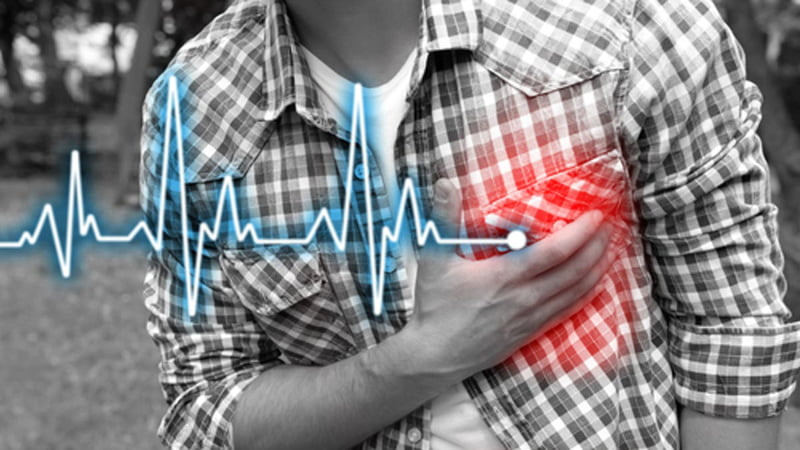 Person with AFib Holding His Chest with Difficulty