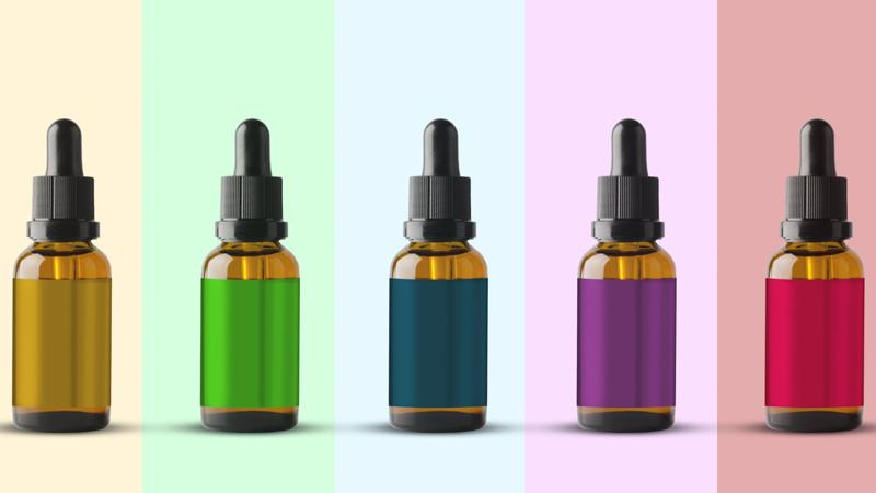 Five Bottles of CBD Oil in Different Color Label